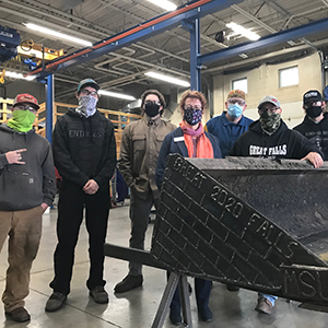 Great Falls College welding students (from left) Orion McKinney, Nate Beeler, Nathan Jones, Daniel Erlandson and Cody McNee restored an old, worn-out bucket into the workforce for a contractor this semester.
